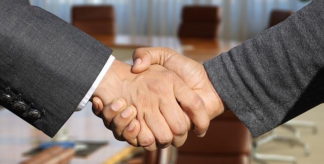 A handshake between two businessmen