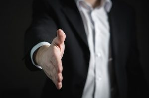 A business person offering their hand for a handshake