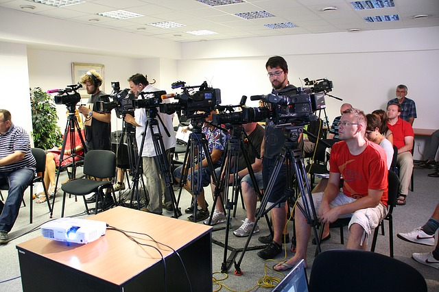 A group of journalists with their cameras before a press conference