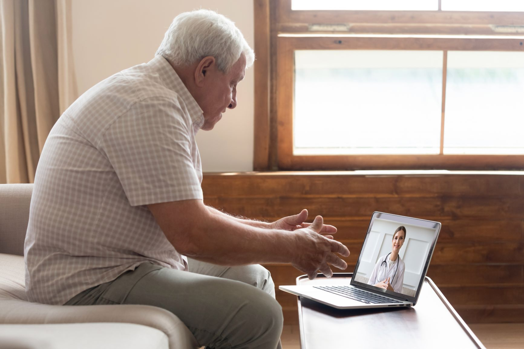Senior male telehealth appointment