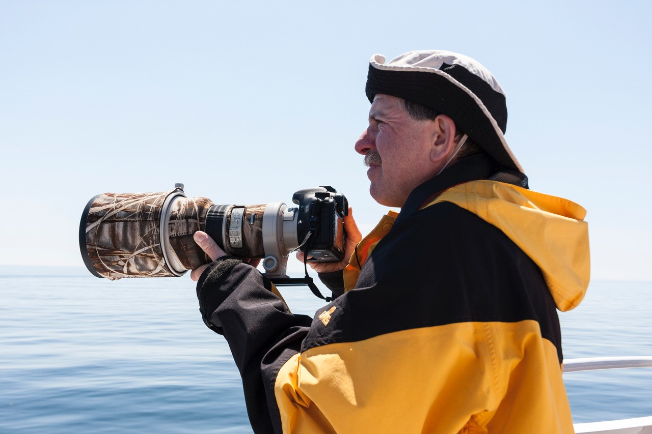Man holding large camera