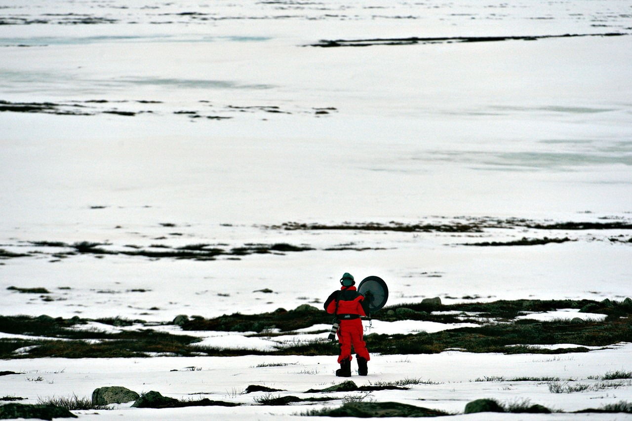 Person in snow suit on snowy field