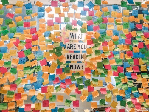 what are you reading now surrounded by post-its