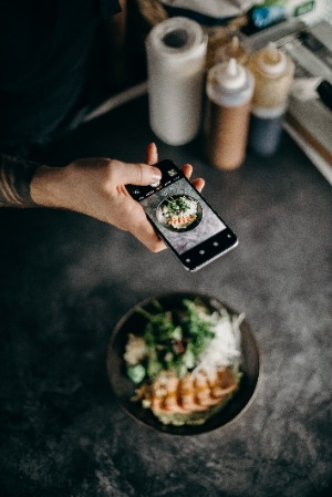 person taking a photo of food