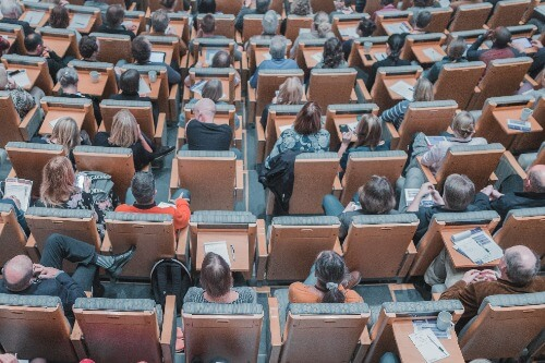 People in chairs at a conference